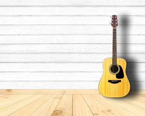 Acoustic guitar in vintage wood room.