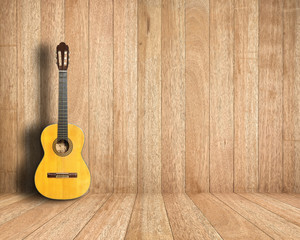Classical guitar in vintage wood room.