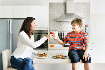 Mom and Son Eating Togetherness Cheerful Concept