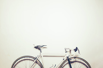 White vintage bicycle on white background