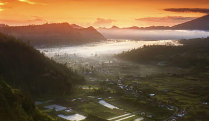 Amazing sunrise over Pinggan Hill, Bali, Indonesia Nature composition, soft focus and vibrant colours.