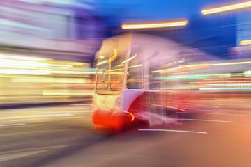 Tram on urban city street with motion blur effect. Poland.