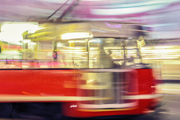 Red tram on street with motion blur effect. Katowice. Poland.