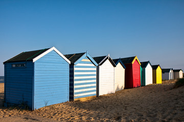 Colourful beach huts on Southwold beach Suffolk