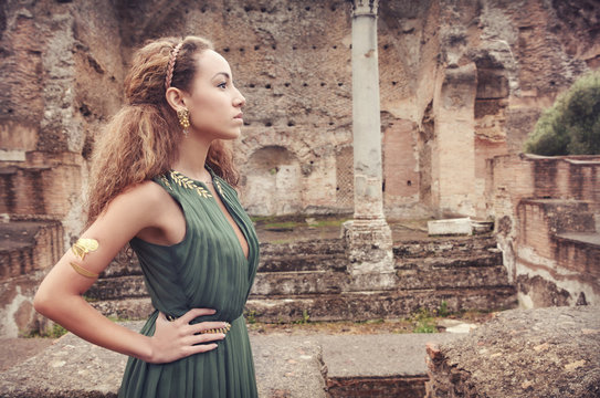 Beautiful woman  near ancient ruins...