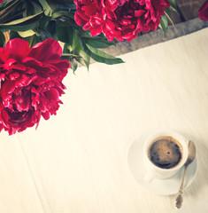 Morning coffee with peony flowers