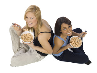 happy girls eating cereals