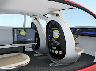 Autonomous car interior concept. Rear screen of front passenger seat display business document, and laptop on the side table show same document. Concept for new business work style in future.