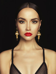 Beautiful lady with earring on black background