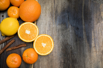 lemon and orange in a white plate on a vintage wooden background