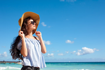 Woman in sunhat on a beach