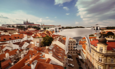 Drone quad copter photographs and records Prague tourist city center.