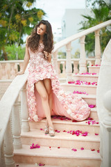 Dream wedding, beautiful bride, walking down stairs with flowers