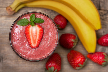 smoothie with banana and strawberry in the glass