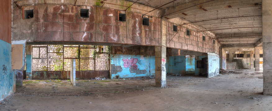 """Panoramic view of the interior of abandoned dilapidated shopping center """"Zhoekvara"""", Gagra, Abkhazia, HDR processing."""