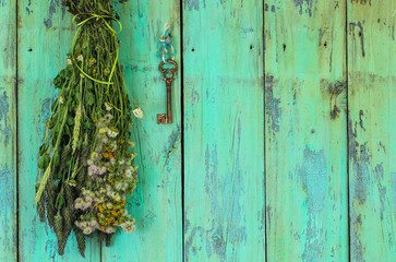 House key hanging by bouquet of dried flowers