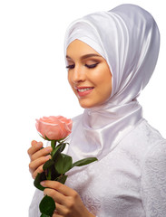 Young muslim woman with rose flower