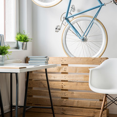 Vertical picture of trendy bicycle in small room