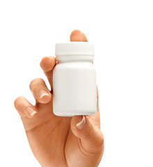 Woman's hand shows bottle for pills isolated on white background. Palm up, close up. High resolution product.