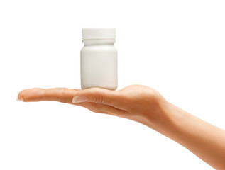 Hand holding medical bottle with pills isolated on white background. Palm up, close up. High resolution product.