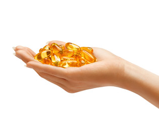 Hand is giving Omega 3 capsules isolated on white background. Palm up, close up. High resolution product.