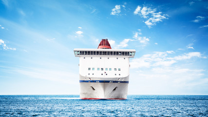 Luxury cruise ship in navigation - front view