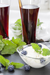 Ice cream with Bog blueberry and lemon balm, Glasses with fresh Black Currant juice