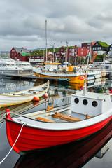 Fishing boats in the harbour of Torshavn in Faroe islands.