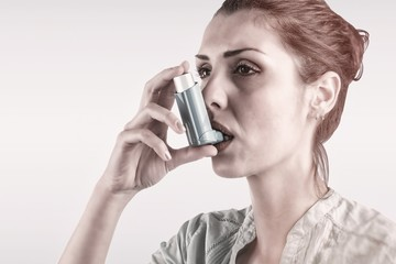 Composite image of portrait of a asthmatic woman