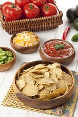 nachos on wooden bowl