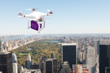 Composite image of a drone bringing a purple cube