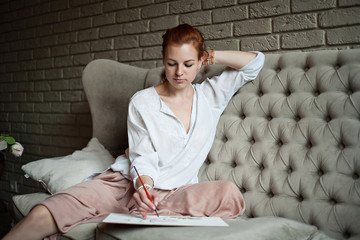 woman artist thinking and drawing
