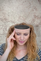 Composite image of blonde woman having headache