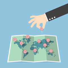 Businessman hand pin target to world map