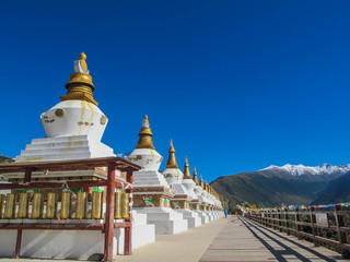 DEQING, YUNNAN CHINA - OCT 21 : Tibetan border, view point, stupas, the way to Deqing with Meili Snow Mountain Peak on October 21, 2015