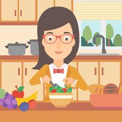 Woman cooking vegetable salad.