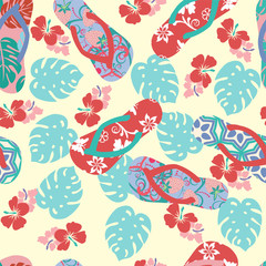 summer background with flower hibiscus and flip flops.