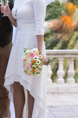 bridal bouquet of roses, freesia, eustoma
