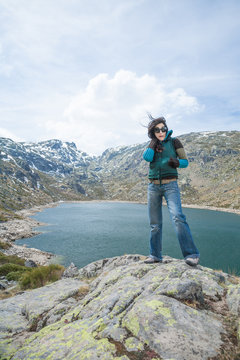 woman wind over lake in mountain