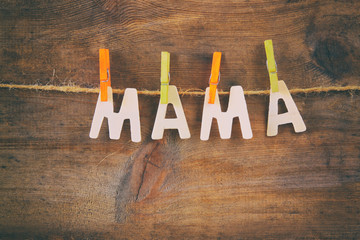 The word MAMA made from wooden letters