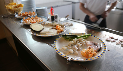 dishes in a Chinese restaurant with the Cook in the background