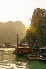 Tourist Junks,  Floating village on sunset in Halong Bay, Vietna