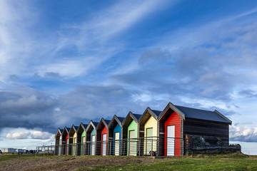 Colourful beach huts at South Beach, Blyth, Northumberland, England, UK.