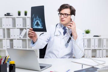 Doctor with x-ray on phone