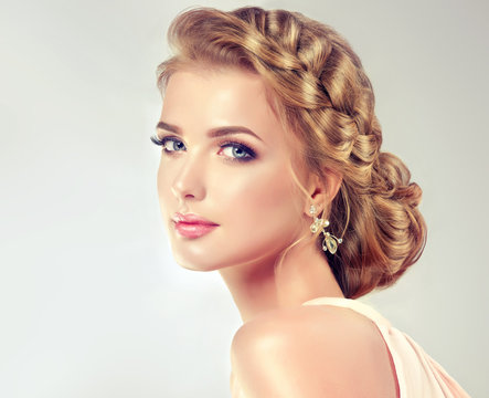 Beautiful model girl with elegant hairstyle . Beautiy woman with fashion wedding hair and colourful makeup