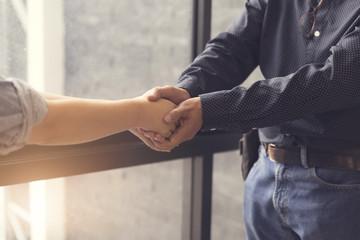 businessman handshaking for business acquisiton concept