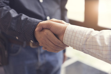 businessman handshaking for business acquisiton concept