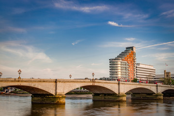 Putney bridge is connecting Fulham to Putney across the river Thames, is the only bridge in britain to have a church at each end, St. Mary's Church, Putney, south and All Saints Church, Fulham, north