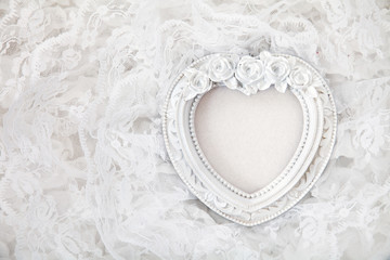 Vintage frame on white lace background