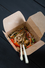 Asian noodles with vegetables in boxes